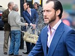Making a splash: Jude Law embraces inner bad boy as he gets in a fight on set of new film Dom Hemingway