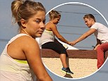 Don't look down! Dancing with the Stars Derek Hough lends partner Shawn Johnson a protective hand during a rooftop break from practice