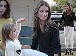 Like mother, like daughter: Alessandra Ambrosio and her daughter colour coordinate their outfits during a trip to the playground