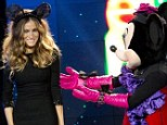 Give me back my ears! Sarah Jessica Parker poses with Minnie Mouse at the premiere of the Disney short film Electric Holidays at Barneys New York in New York