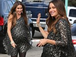 She must be ready to pop! Sofia Vergara shows off her huge prosthetic baby bump in a sparkling tunic on Modern Family set