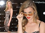 She's purrrfect to show off some specs appeal! Georgia May Jagger struts her stuff in leopard print dress as sports new sunglasses range in Sydney