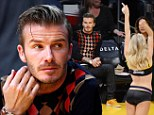 Keep looking down! David Beckham attends Lakers Game ... and tries really hard not to look at the scantily clad dancers