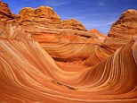 The Wave: (Utah, USA) Carved rock eroded into a wave-like formation made of jurrasic-age Navajo sandstone that is approximately 190 million years old