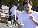 Another thing he's ace at! Leonardo DiCaprio tries his hand at tennis as he films prison scenes for Wolf of Wall Street