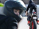All revved up: Justin Bieber hits the road on his beloved Ducati motorbike, just 24 hours after being slapped with driving ticket