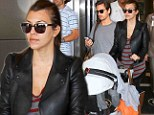Back to reality: Kourtney Kardashian is low key in leather as she and Scott Disick jet into Miami after whistlestop trip to Europe