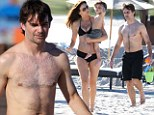 Family time: Jeff Gordon and wife Ingrid Vandebosch took their son Leo to a Miami beach on Thursday