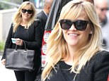 It's back to work time! Reese Witherspoon attends business meeting and shows off post pregnancy curves in sharp black trousers and blazer