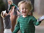 You little rascal! Owen Wilson scoops up mini-me son Robert and showers him with affection after the tiny tot escapes with his cell phone