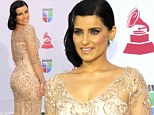 Cream of the crop! Nelly Furtado steals the arrivals show at the Latin Grammy awards in a stunning embroidered gown