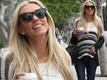 Tamara Ecclestone patted an unmistakable tummy bump while out shopping at a baby store on Thursday