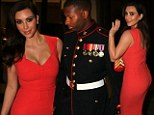 Eyes on the prize: Kim Kardashian stuns in red at Marine Corps Ball... leaving her date struggling not to stare