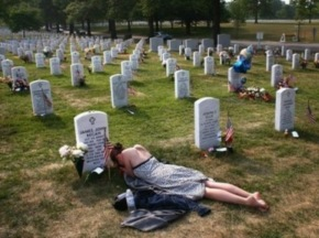 Beyond The Headlines Honoring Those Who Made The Ultimate Sacrifice - A woman mourns the death of her loved one at Arlington. Photo credit:  Getty Images