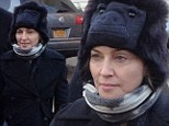 No monkeying around here: Make-up free Madonna dons gorilla hat as she visits New York area damaged by Superstorm Sandy