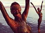 She looks muddy marvellous! Stacy Keibler covers herself in muck on Dead Sea trip