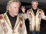 Heeeeere's Gary! Actor Busey shows off his eccentric style as he touches down at LAX in antique jacket