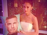 Still on good form: Nicole still has her quirky sense of humour despite her difficult week as she holds up a cushion with Gary Barlow's face on it