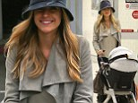 New Mom Kristin Cavallari dotes on baby Camden as she touches down in LAX