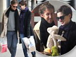 Getting some practice in? Anne Hathaway and new husband Adam Shulman are all smiles as they shop for children's toys