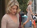 Ali Larter mixed glamour with comfort by wearing a stylish dress and snug boots on set in California on Thursday.