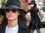 Interesting gym attire! Olivia Wilde wears overcoat and patterned trousers as she heads for workout