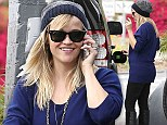 Glowing with pride! Reese Witherspoon shows off glorious post baby curves in blue sweater and knee high boots