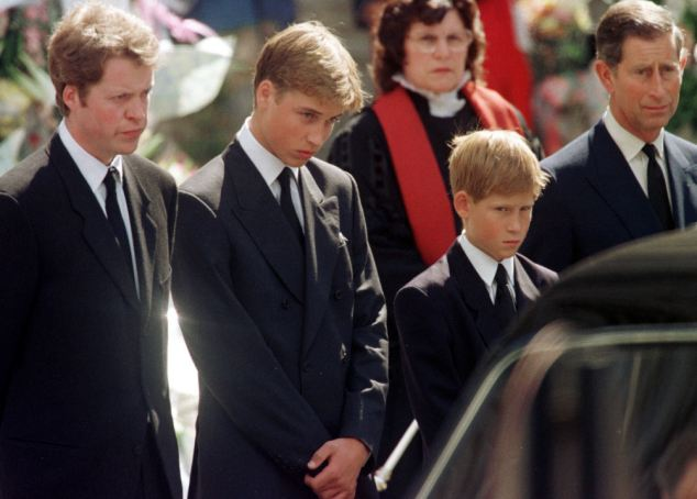 Forgiven: (Left to right)  Earl Spencer, Prince William, Prince Harry and Prince Charles look at the coffin of Diana, Princess of Wales.