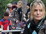 Rain, hail or shine a make-up free Heidi Klum is a model mum braving bad weather to watch her son play football
