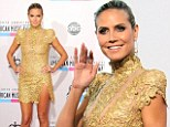 Going for gold! Heidi Klum and her thigh-high split steal spotlight from pop's finest on American Music Awards red carpet
