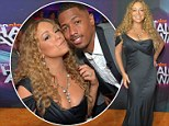 Busting out! Mariah Carey showed off daring cleavage while cheering on husband Nick Cannon at the HALO Awards in L.A.