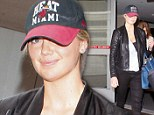 Make-up free Kate Upton is not ready for the runway as she hides under hat on trip through airport