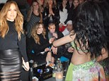 She won't be outdone by a belly dancer! Jennifer Lopez makes sure to distract Casper Smart by wearing a racy sheer and leather skirt at raunchy show