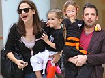On the go: Jennifer Garner flew home and ferried Seraphina to karate class and was later joined by husband Ben Affleck and Violet