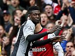 Sorry: Emmanuel Adebayor (left) apologised to his team-mates, manager and Tottenham's fans after being sent off for a tackle on Santi Cazorla