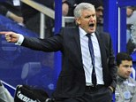 Feeling the heat: Mark Hughes faces an uncertain future after once again failing to win at home