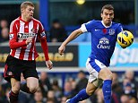 Threat: McClean refused to wear a poppy in Sunderland's game against Everton