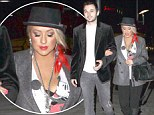 Date night: Christina Aguilera stepped out for dinner with boyfriend Matthew Rutler flashing scarlet hair and wearing a sexy, low-cut Mickey Mouse shirt