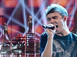 Taking the stage: (L-R) Singers Siva Kaneswaran, Tom Parker, Nathan Sykes, Max George and Jay McGuiness from The Wanted perform onstage during rehearsals for the 40th American Music Awards held at Nokia Theatre L.A. Live on November 16