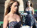 Jennifer Love Hewitt almost busts out of her strapless frock on set of The Client List