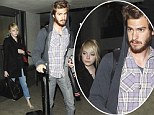 Chasing the sun: Sombre Emma Stone and Andrew Garfield arrive in chilly LA from the even colder East Coast