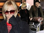 A tired Carey Mulligan flies into Los Angeles wearing her husband Marcus Mumford's clothes