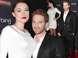 Comfortable with his masculinity: Seth Green is happily dwarfed by his statuesque (and shapely) wife Claire Grant