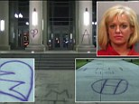 A patrolling officer caught Dostie in the act with a can of spray paint at the courthouse and arrested her.