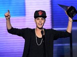 Defiant: Justin dedicated his first award to his critics but luckily got two more chances to thank the people who count