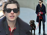 Windswept Anne Hathaway keeps it casual as she goes make-up free on stroll with pet pooch Esmeralda