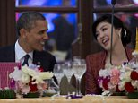 Celebration: Obama enjoys a joke with PM Shinawatra during a state dinner in Thailand