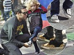 Like father, like son! Punk rocker Pete Wentz and son Bronx sport cool kicks on a day out at the farmers market