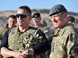 The 007 actor joined 800 soldiers, sailors and airmen at the base in Helmand Province as they prepared to watch the latest instalment in the spy series, Skyfall