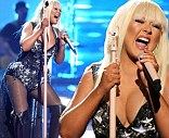 Christina Aguilera performs Lotus, Army of Me and Let There Be Love at the 40th Anniversary American Music Awards on Sunday